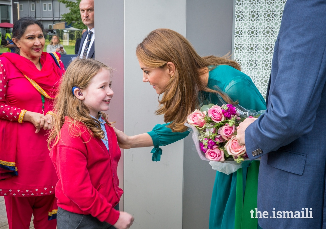 The Duchess of Cambridge shares a moment with a student from the Kings Cross Academy.