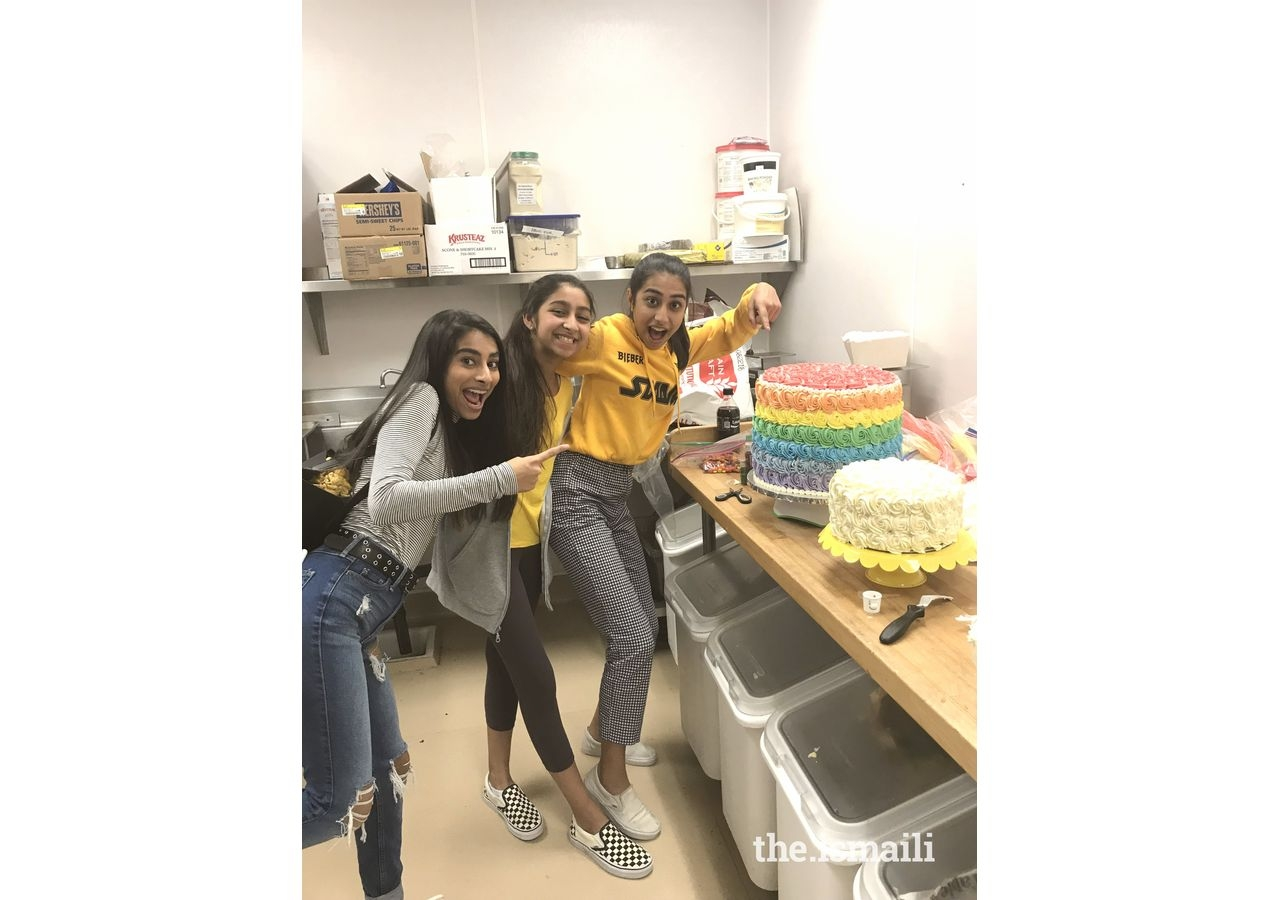 Natasha Jiwani (center) baking treats with her sisters