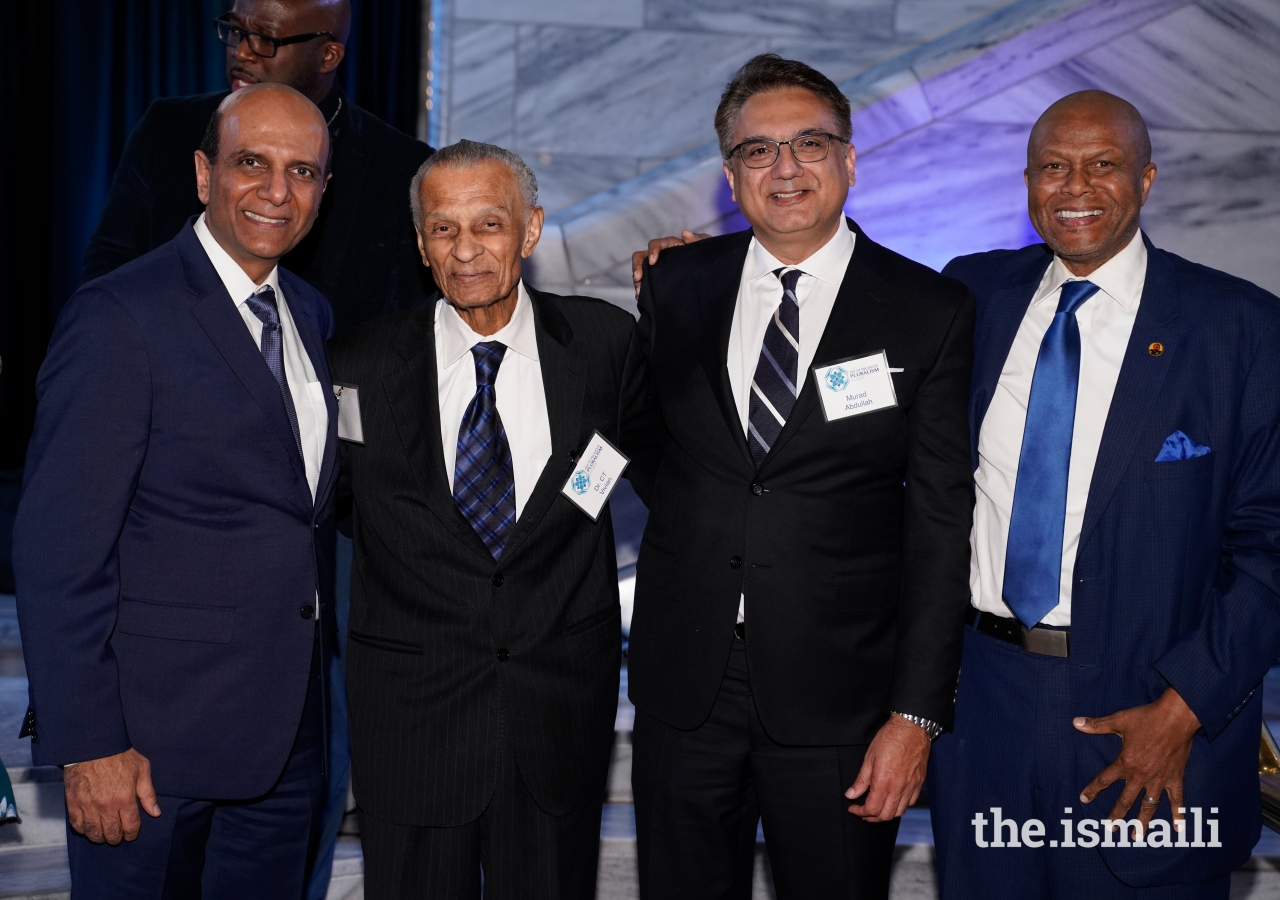 Vice President Zahir Ladhani, Dr. C.T. Vivian, President Murad Abdullah, and Don River pose for a picture at the Day of Religious Pluralism held on the 51st death anniversary of Dr. Martin Luther King, Jr., to honor his legacy of building a Beloved Community.