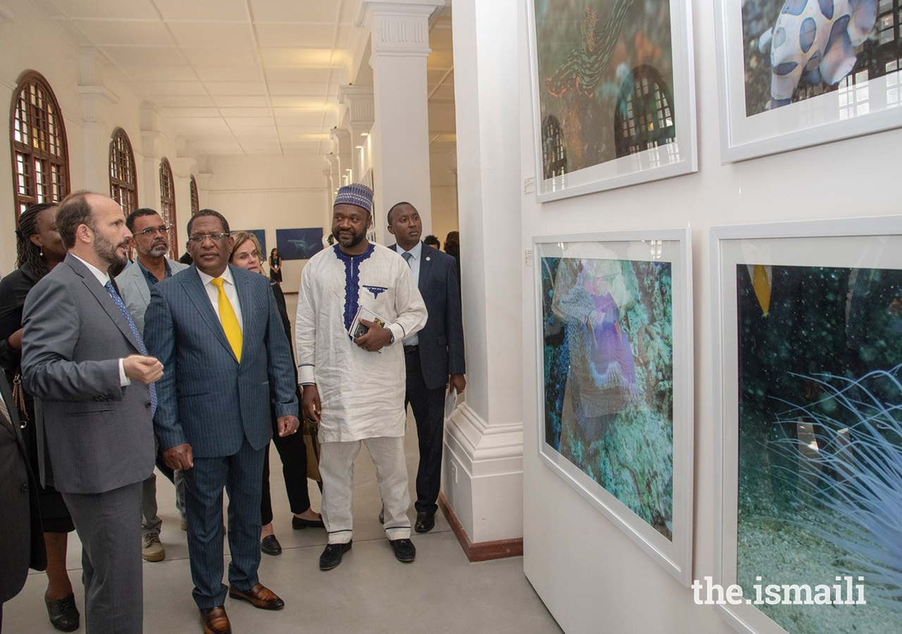 Prince Hussain describes some of the distinguishing features of marine animals exhibited in the collage as Cabinet Secretary Honourable Keriako Tobiko, and panelists David O. Obure, Doreen Robinson and Dr. Cyrille-Lazare Siewe look on with keen interest.