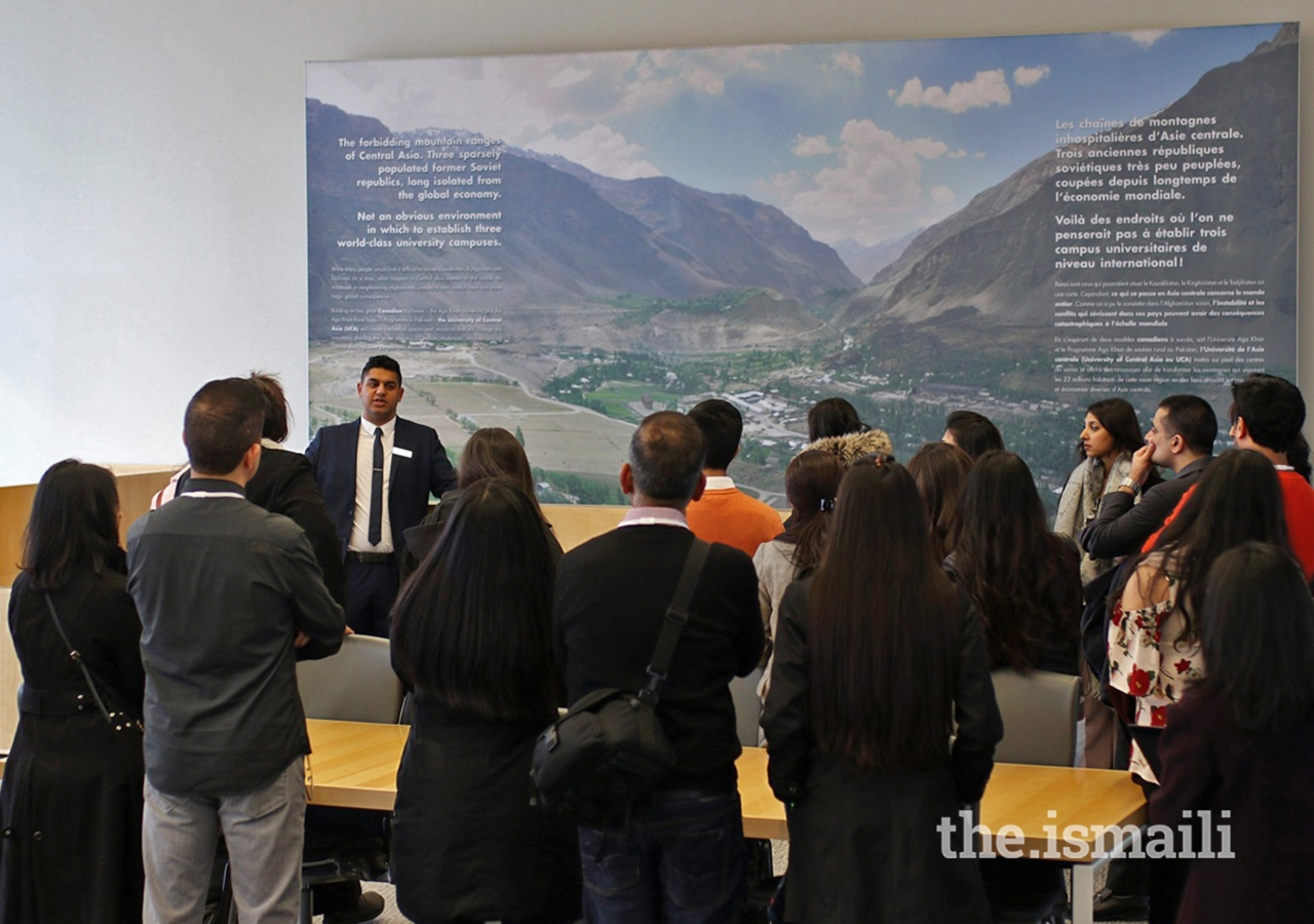 A guide leads a group of Jubilee Heritage participants on a tour of the Delegation of the Ismaili Imamat.