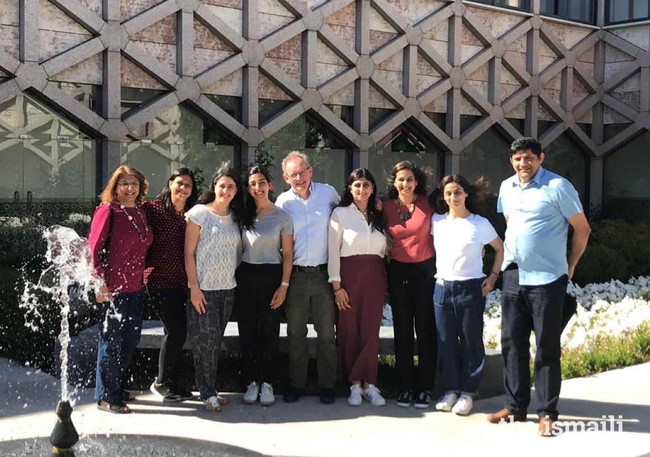 On the Parenting Journey organisers and participants gather for a group photo in the courtyard at the Ismaili Centre, Lisbon.
