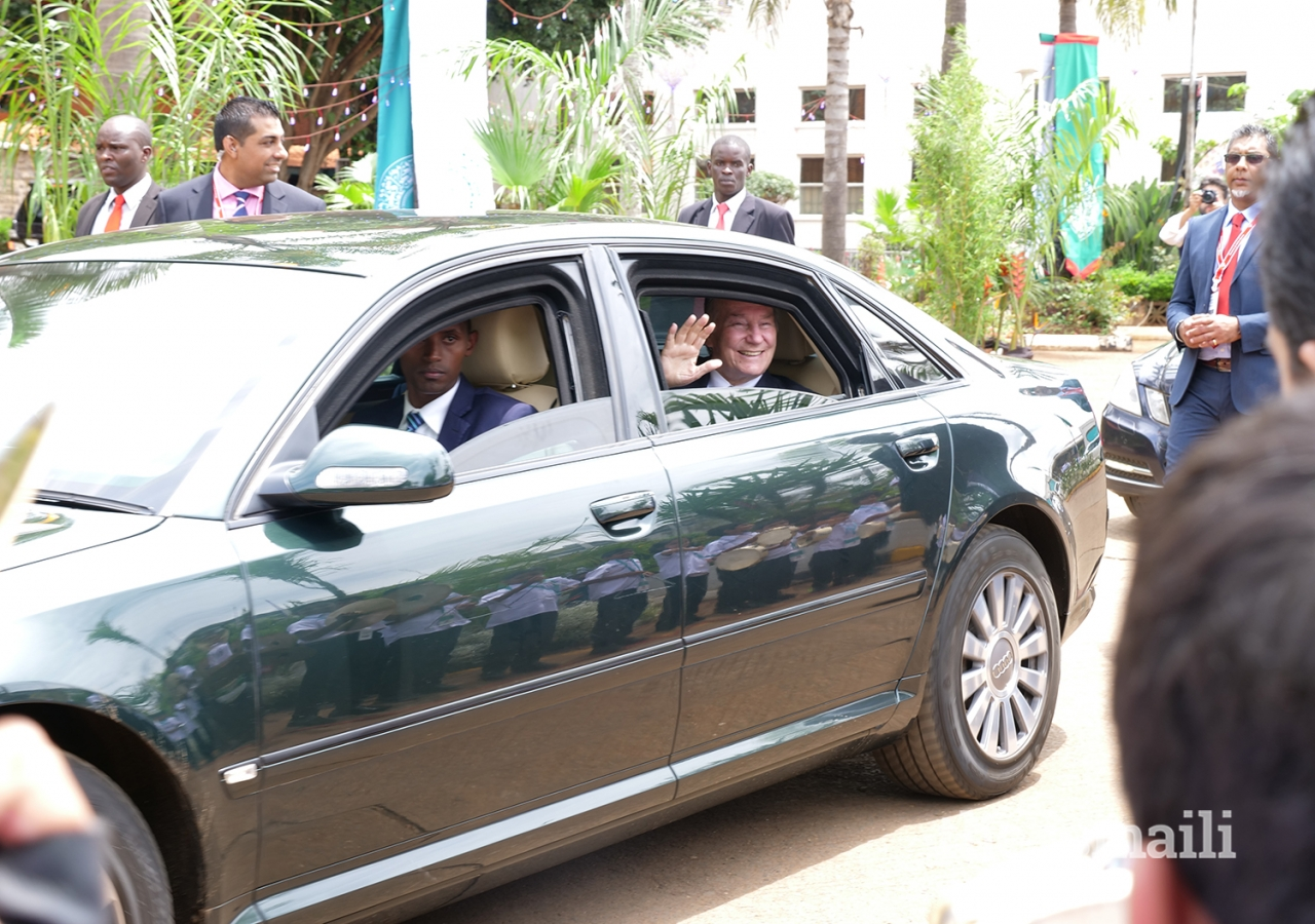 Mawlana Hazar Imam waves to young volunteers after departing the Darbar hall