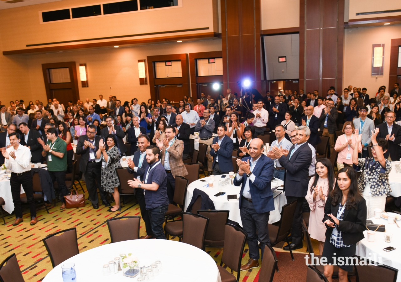 The participants rise in applause to show their appreciation for the volunteers and organizers as the DJAC weekend comes to a close.