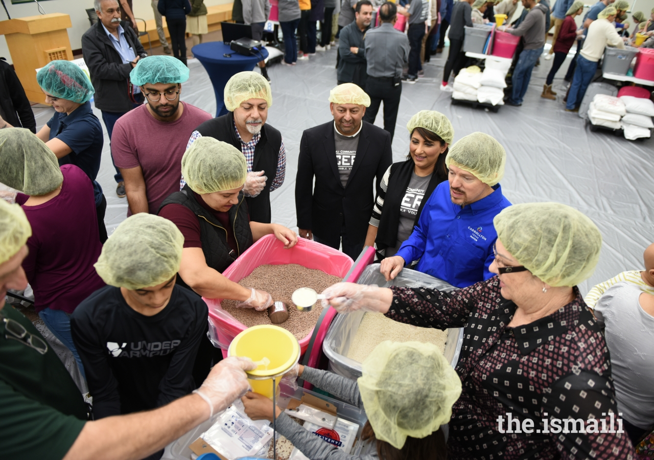 Carrollton Mayor Kevin Falconer, Consul General of Canada Vasken Khabayan, Aga Khan Council leaders, along with other officials, participated in the meal assembly line to support the Thanksgiving Day of Service.