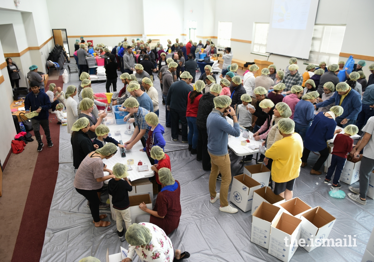 Over 400 jamati members and friends from the larger community volunteered to pack meals over 4 hours on the Day of Thanksgiving.