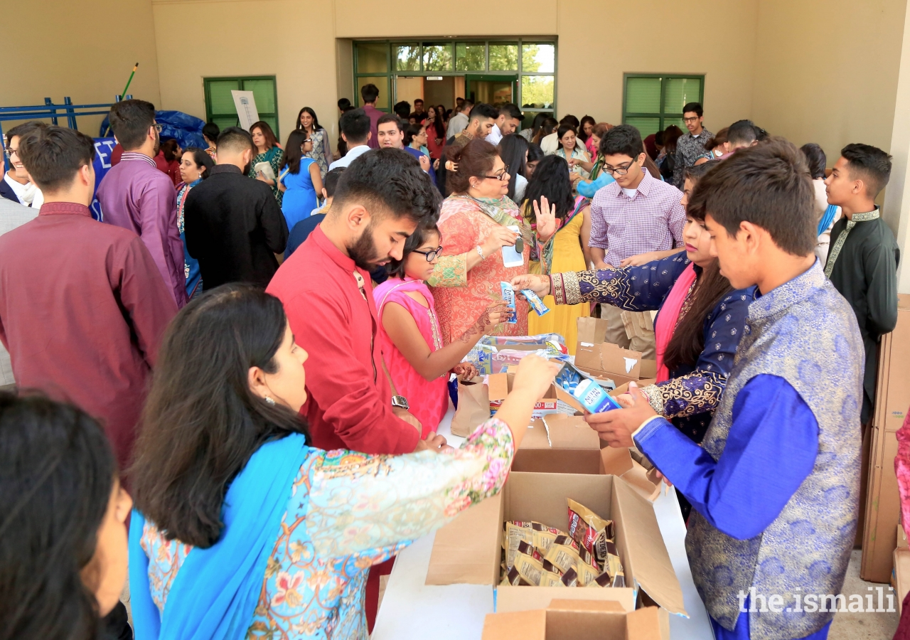 The Jamat in the Dallas area preparing 6,000 snacks for local charities.