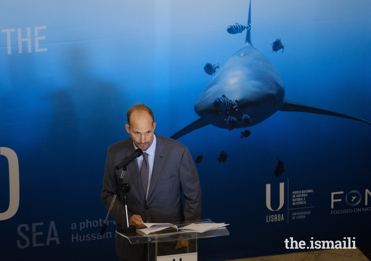 Prince Hussain addresses guests at the inauguration of his The Living Sea photo exhibition in Lisbon.