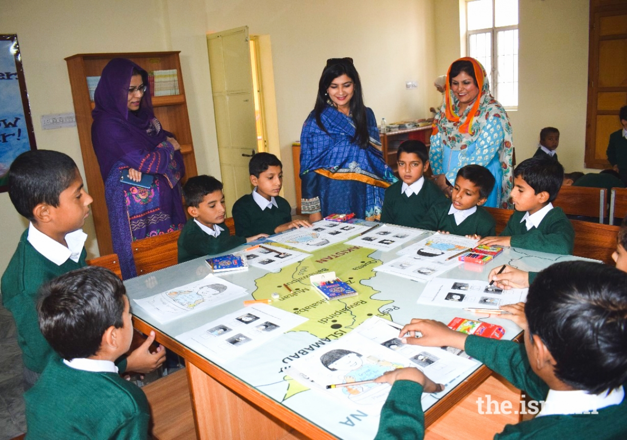 Nasreen Aman in a classroom with the children.