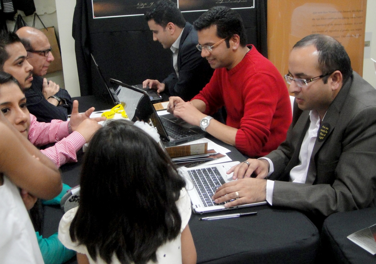 Volunteers in Sydney book reservation times for the Jamat ahead of the arrival of RAYS OF LIGHT. Ismaili Council for ANZ