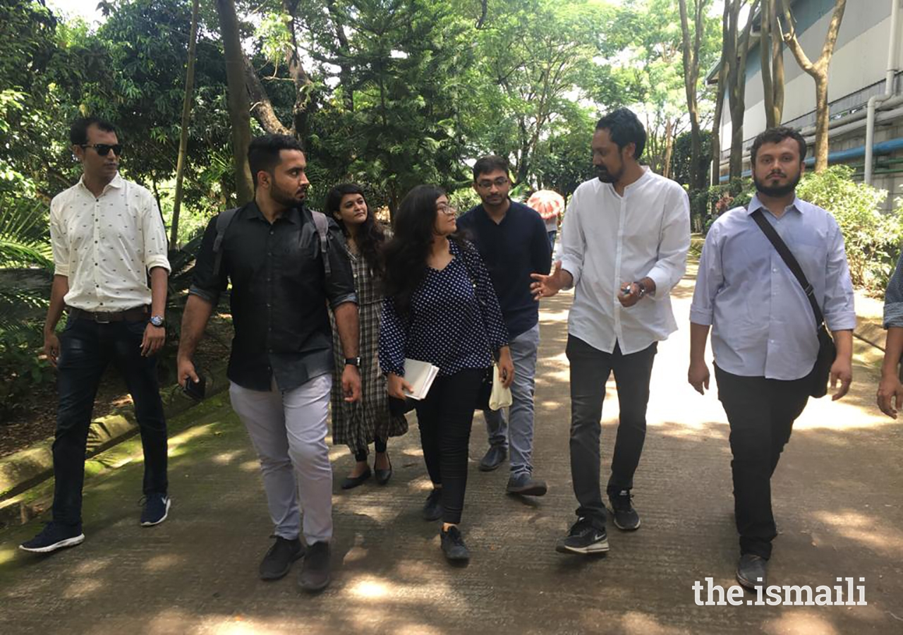 In conversation with Jubair Hasan, second from right. Mr Hasan's project, the Amber Denim Loom Shed, was shortlisted for the 2019 Aga Khan Award for Architecture. Mr Hasan spent the day with the group, taking them around his principal projects.