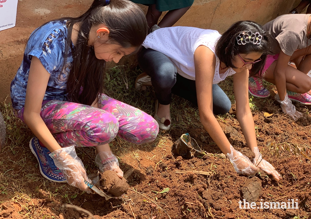Volunteers at the school painting event planted over 100 plants and trees. All building materials, as well as the plants and the trees, were donated by members of the Jamat.