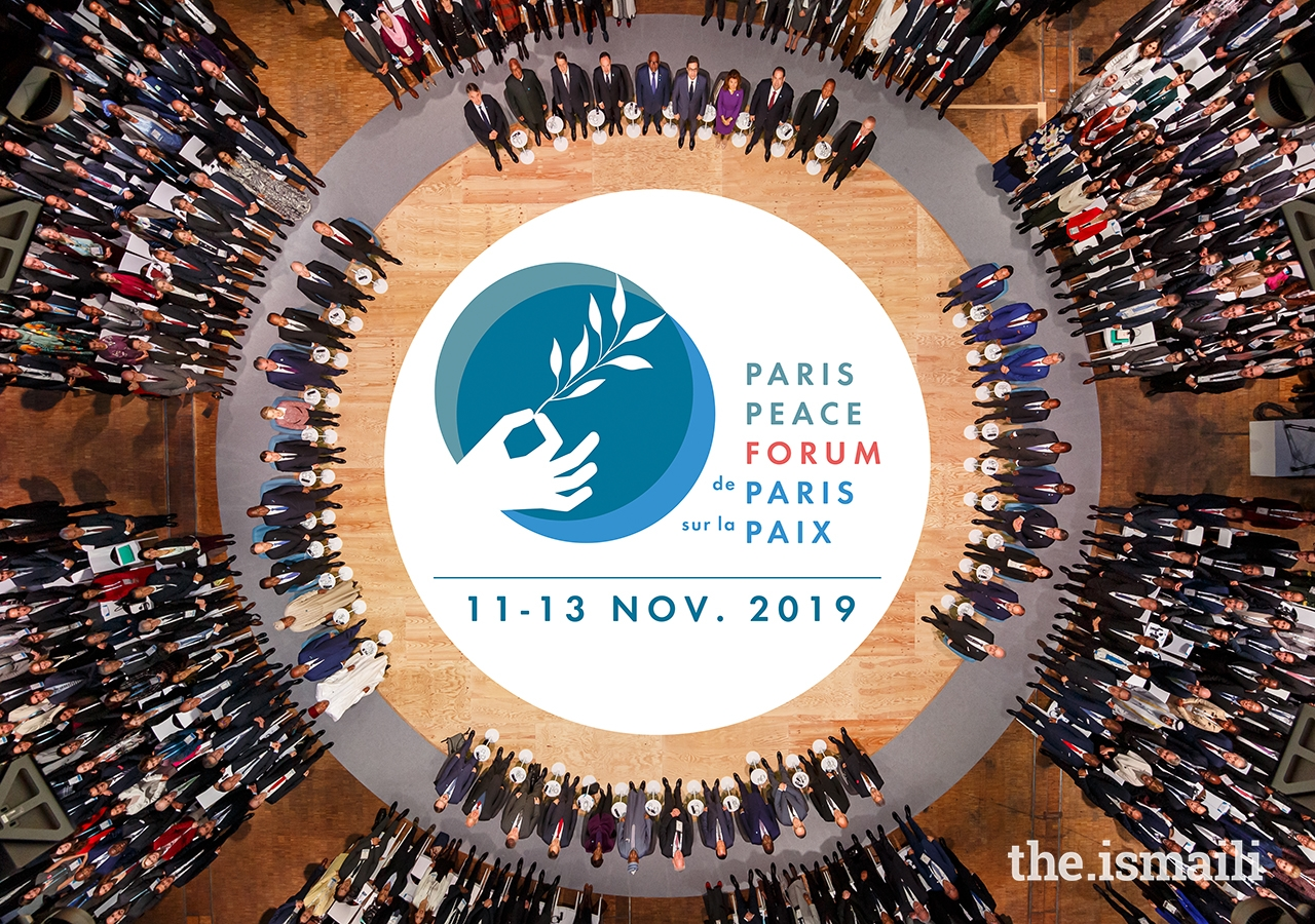 The official photograph of the participants at the opening session of the 2019 Paris Peace Forum.