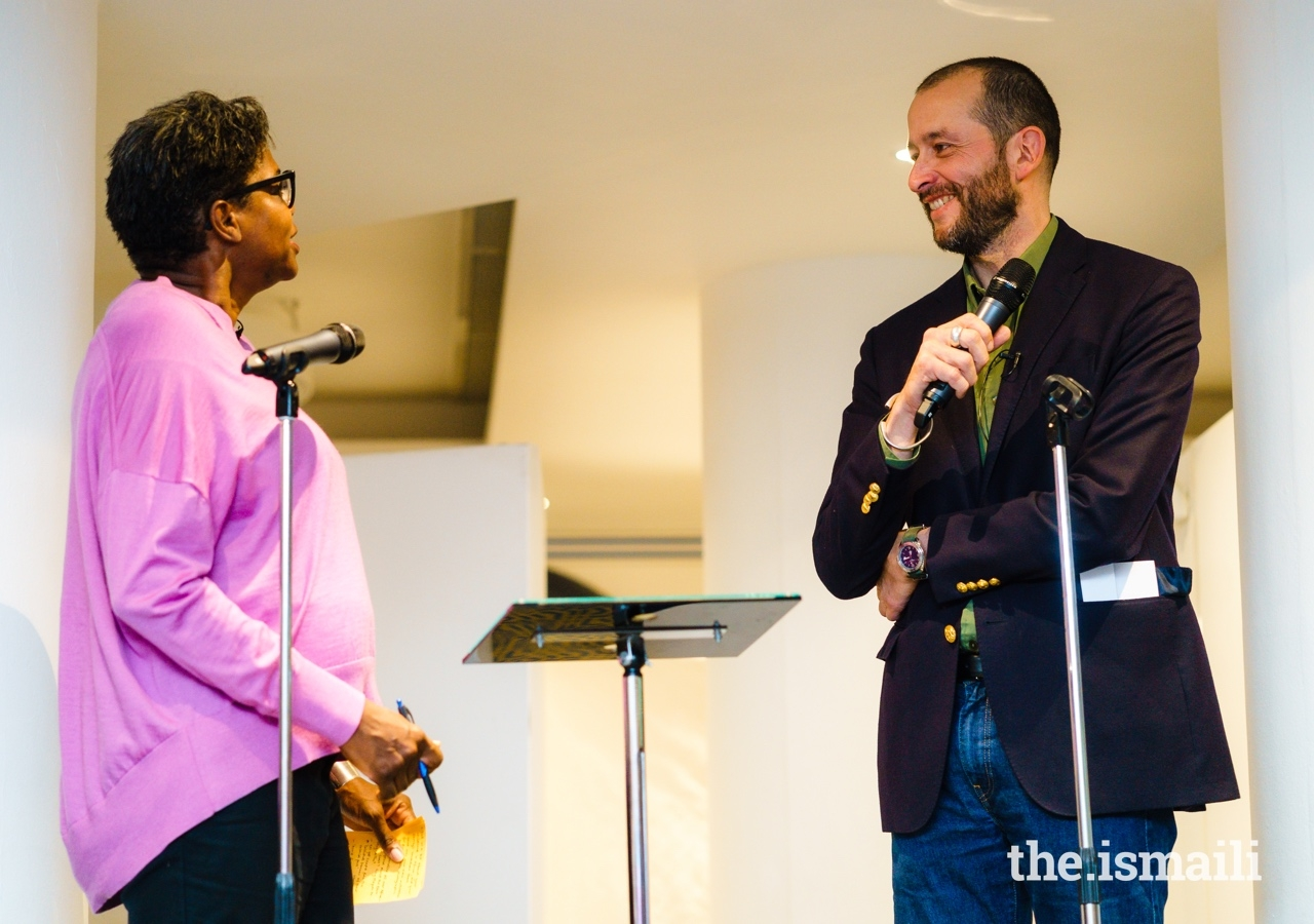 Artist Guillaume Bonn participates in an on-stage conversation with Dr Dayo Forster (left), at the inauguration of the Dreams and Dystopias exhibition at the Ismaili Centre, London.