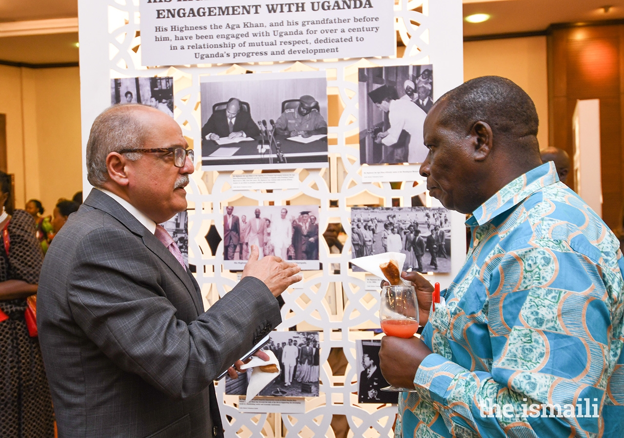 Ismaili Council for Uganda President Minaz Jamal (left) discusses one of the exhibition panels at the AKDN-hosted lecture on the Buganda Kingdom.