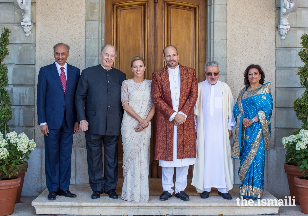 Prince Hussain and Princess Fareen pose for a group photograph with Mawlana Hazar Imam; Vahid Khoshideh, President of the Association Islamique et Culturelle d'Ahl-el-Bayt de Geneve (centre right); Mahmoud Eboo, Chairman of the Leaders' International Forum; and his wife Karima Eboo.