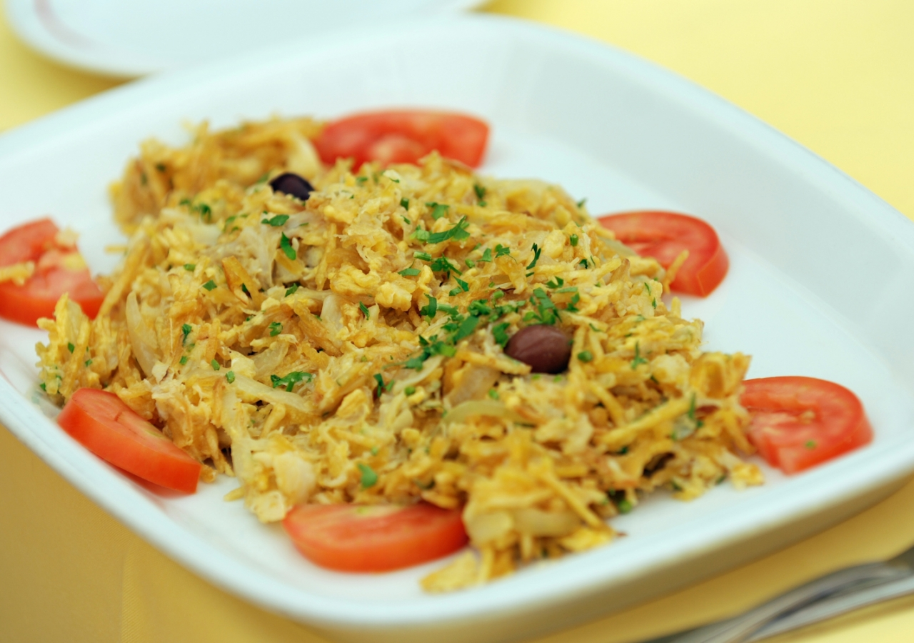You're guaranteed to get your fill of codfish while in Portugal! Enjoy this shredded codfish version as the perfect brunch item.