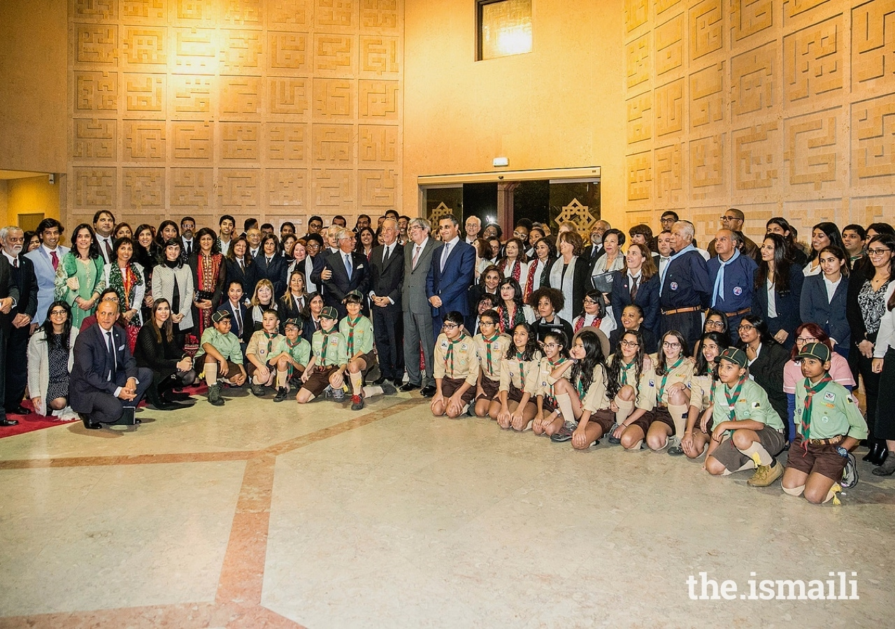 President of the Portuguese Republic, Marcelo Rebelo de Sousa, joins leaders of the Jamat and AKDN, volunteers, and Aga Khan Scouts for a group photograph.