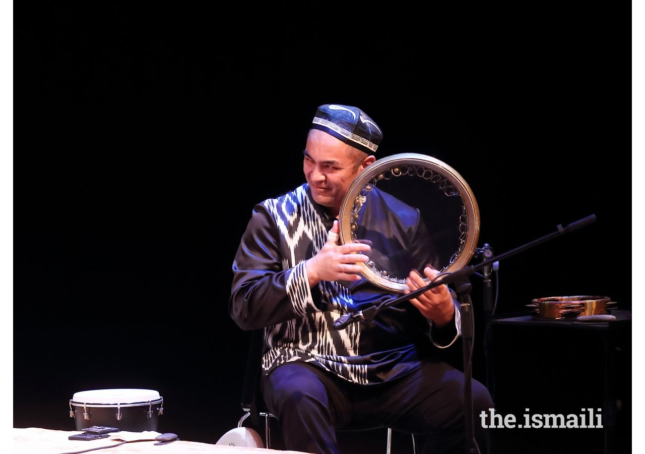 Abbos Kosimov plays the frame drum at the Asia Society Center Texas.