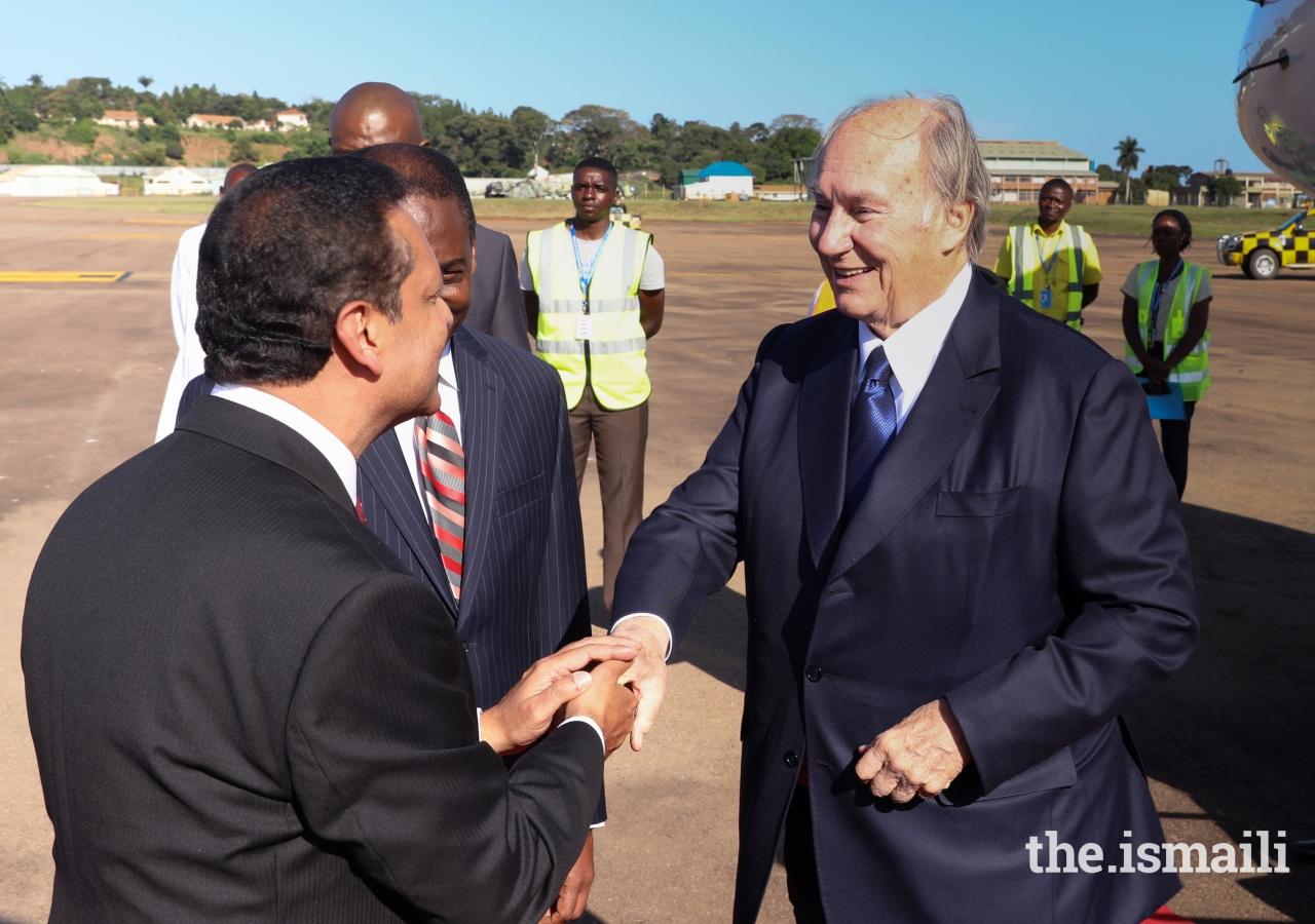 AKDN Resident Representative Amin Mawji greets Mawlana Hazar Imam.