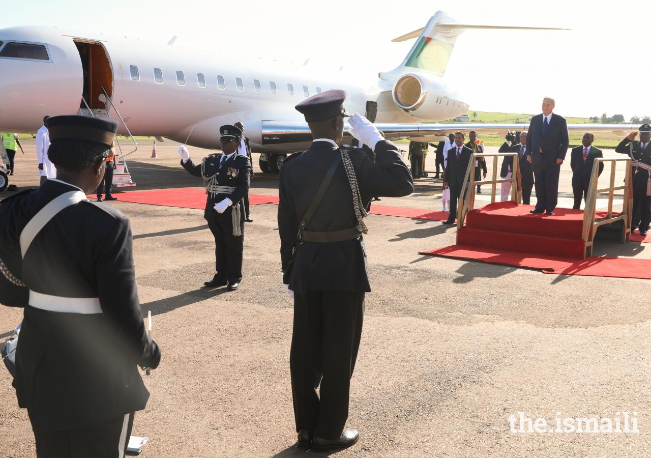 Mawlana Hazar Imam at Entebbe Airport as the Uganda Police Band plays the Nashid al Imamah and the Ugandan National Anthem.