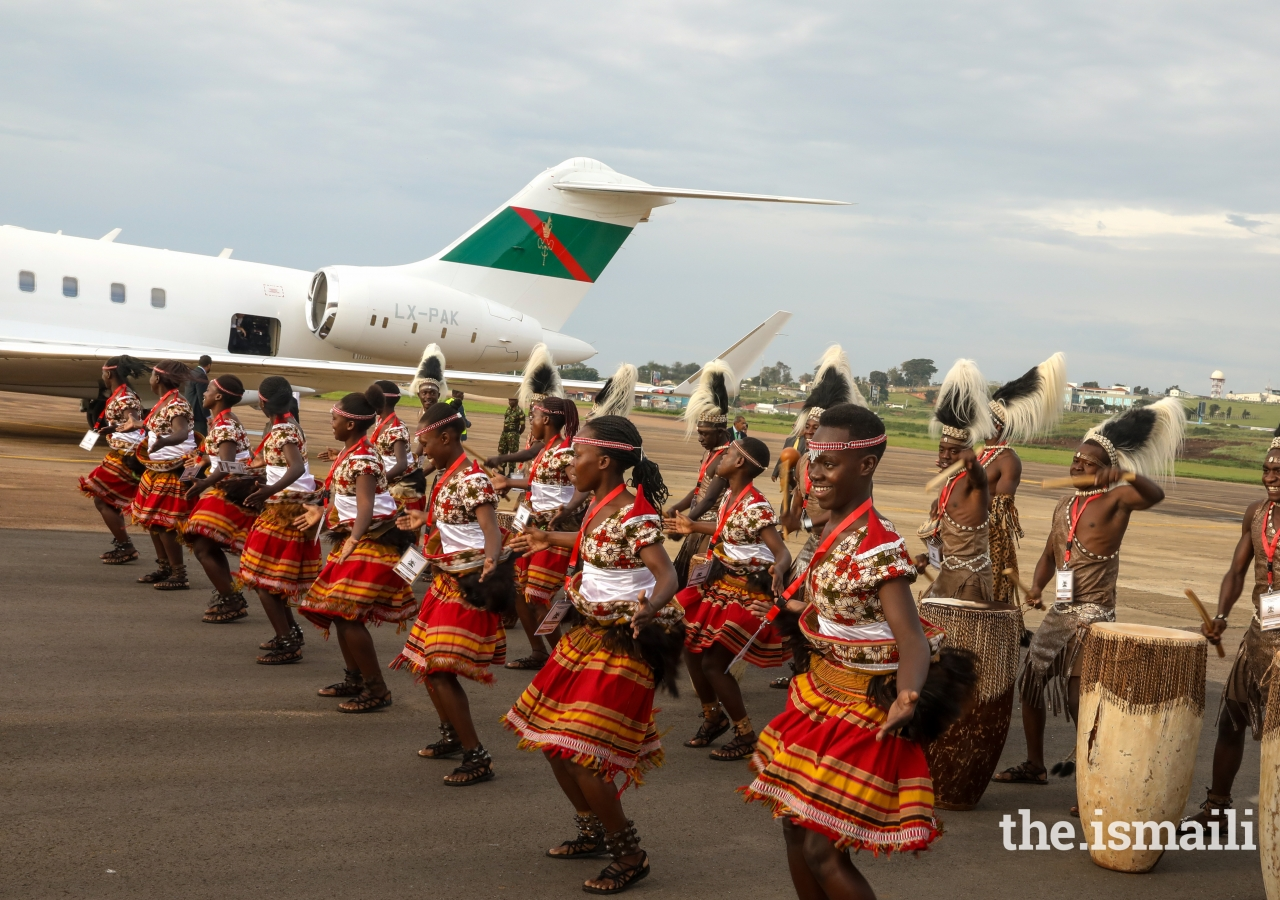 Local dancers perform a traditional dance at the Entebbe airport during Mawlana Hazar Imam's departure from Uganda.