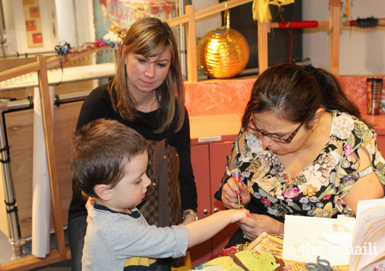 Children and parents alike were mesmerized by the intricacies of the henna artists.