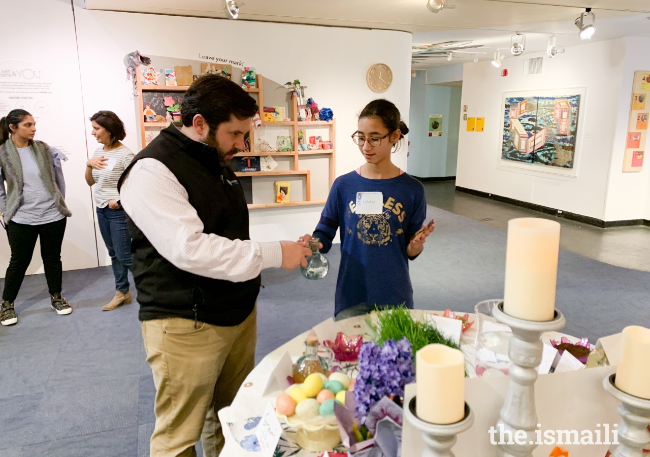 Young Ismaili volunteers, Iman Tuan and Sameer Walji, explained the symbolism behind the many items displayed on the haft-sin table, the centerpiece of Navroz celebrations.