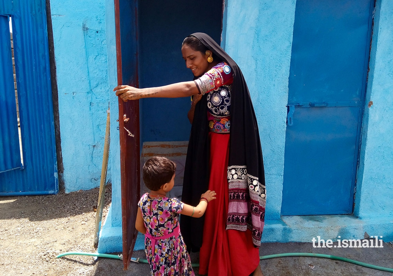 rama-ben-from-gujarat-with-her-new-toilet.-the-introduction-of-toilets-has-made-a-substantial-difference-to-community-health-outcomes-in-areas-where-akahi-has-implemented-its-ehip