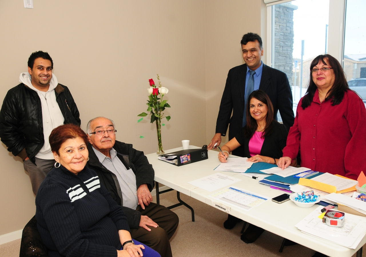 Residents transitioning, with the help of volunteers,  to their new home in Generations Phase I