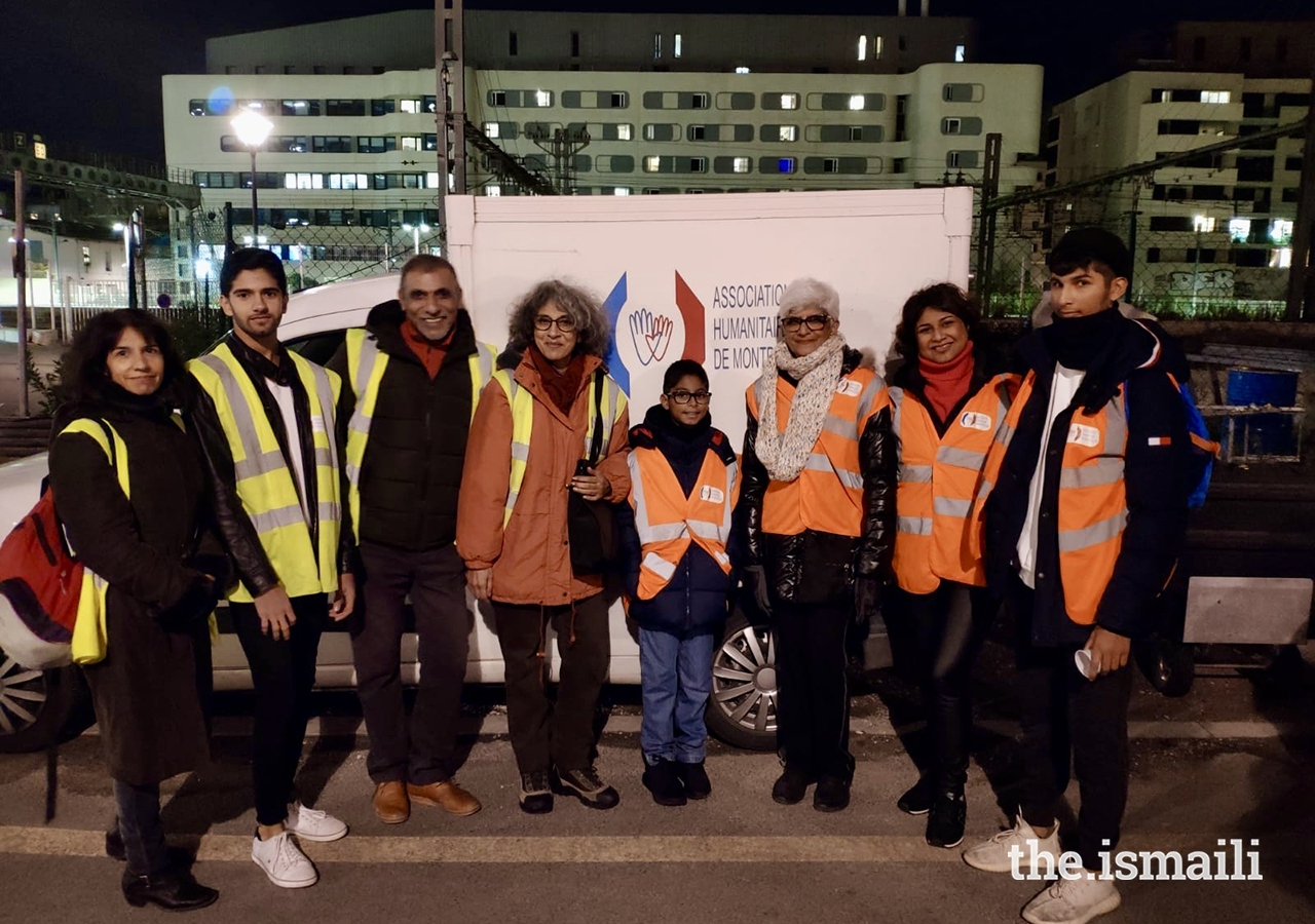 Volunteers in France distribute sandwiches, bottles of water, biscuits, and litres of soup to those in need to mark the 100th anniversary of the Ismaili Volunteer Corp.