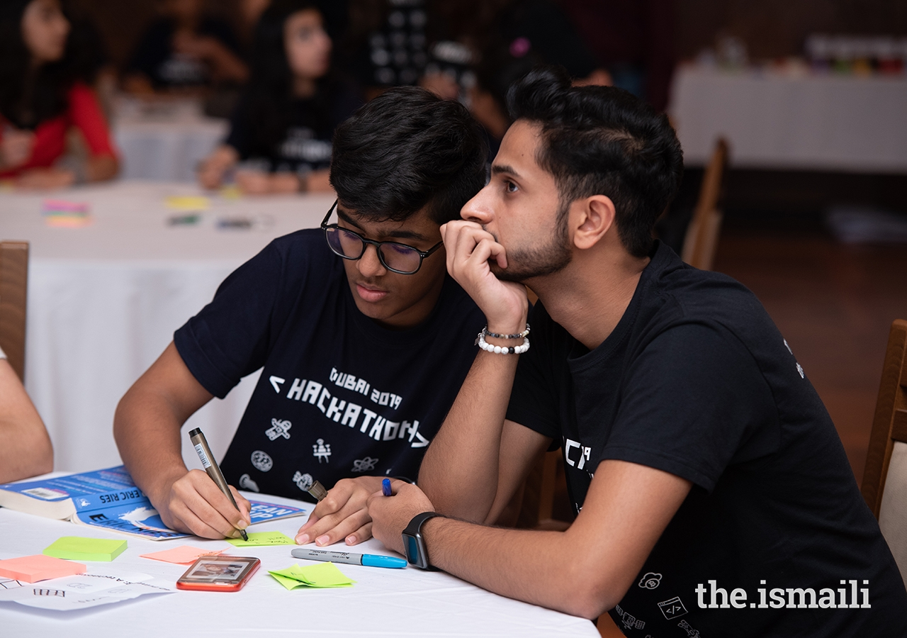 Hackathon Dubai participants contemplate solutions to real-world technological problems.
