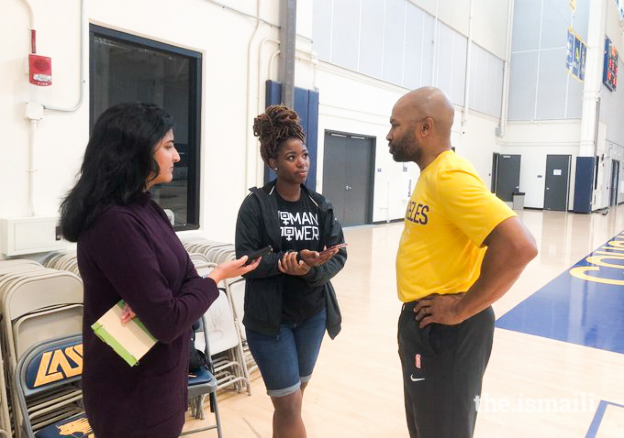 Sabreena Merchant interviewing Sparks head coach and five-time NBA champion with the Lakers, Derek Fisher