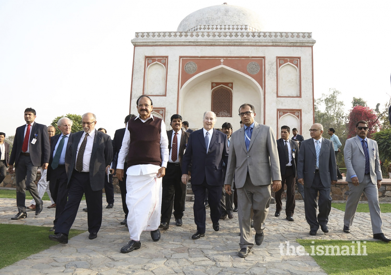 Mawlana Hazar Imam, Honourable Vice President Shri M. Venkaiah Naidu, and dignitaries tour the grounds of Sunder Nursery in New Delhi, India.