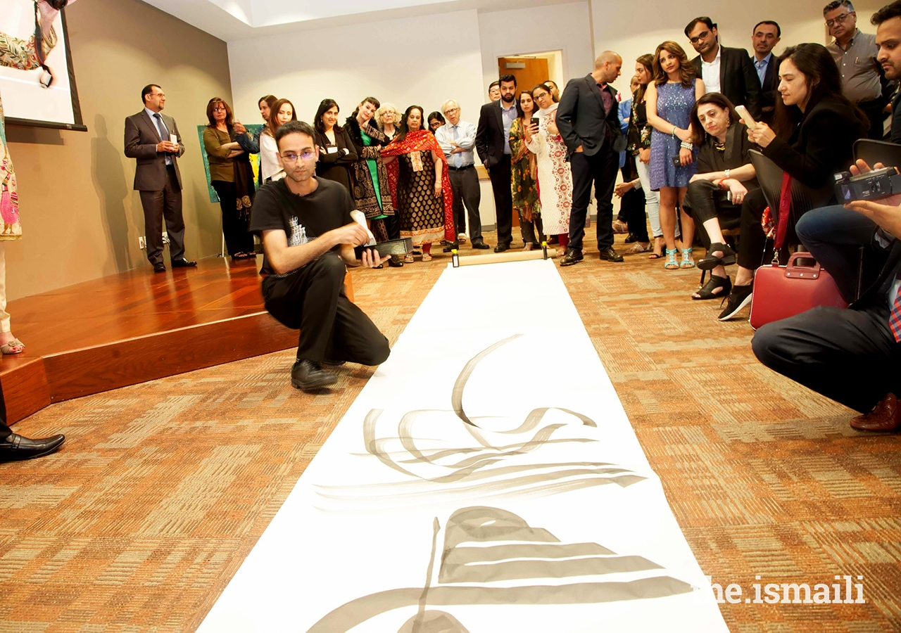 Musicalligrapher Bahman Panahi illustrating his work at Plano Jamatkhana during the Art Symposium dinner.