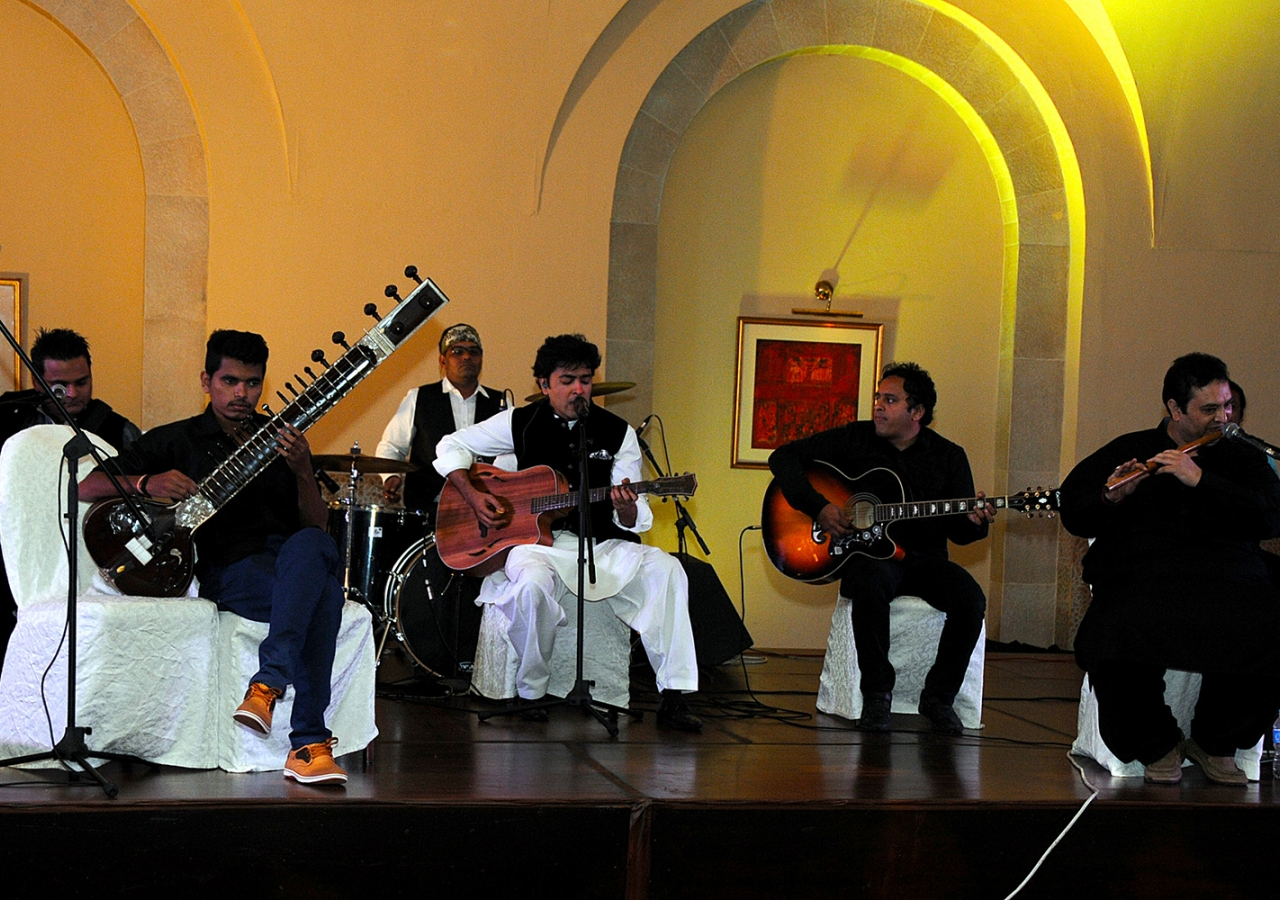 Musicians led by Pakistani-Ismaili singer Shehzad Roy perform before Princess Zahra and Prince Rahim at the institutional dinner. Al-Jalil Ajani