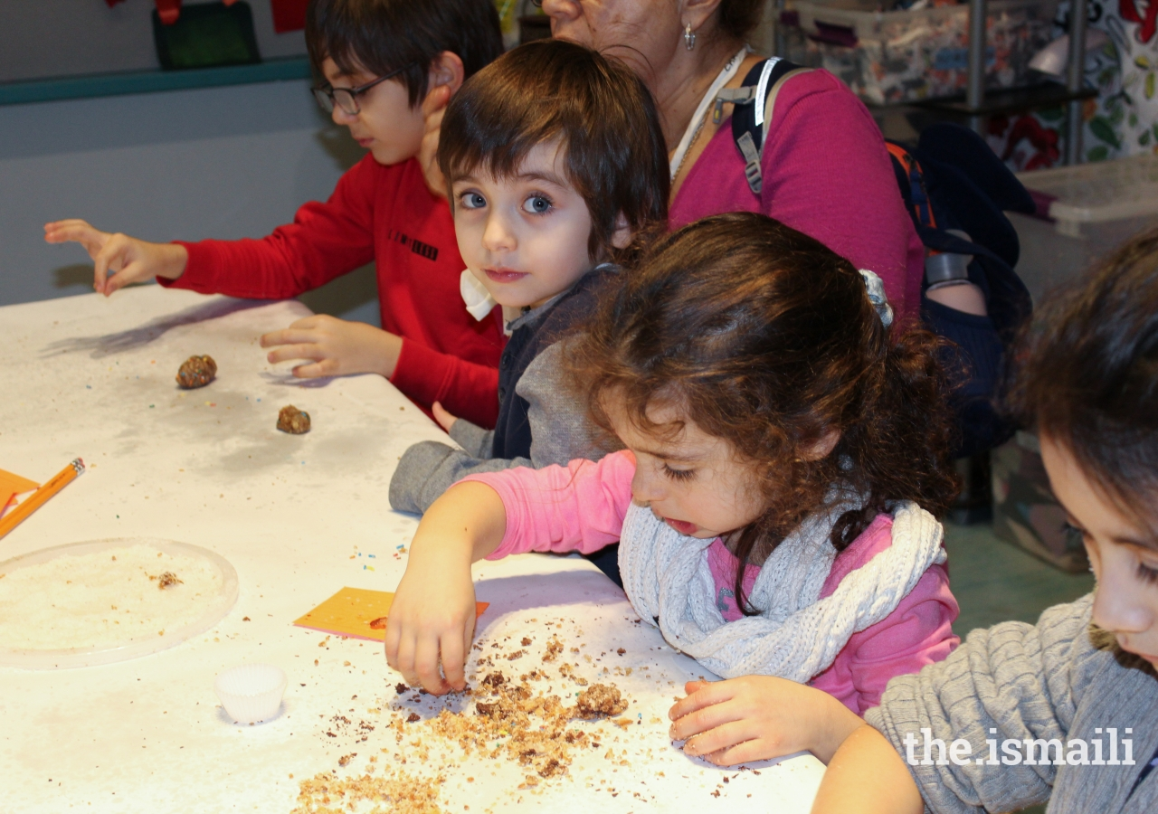 Young museumgoers made delicious Persian date balls.