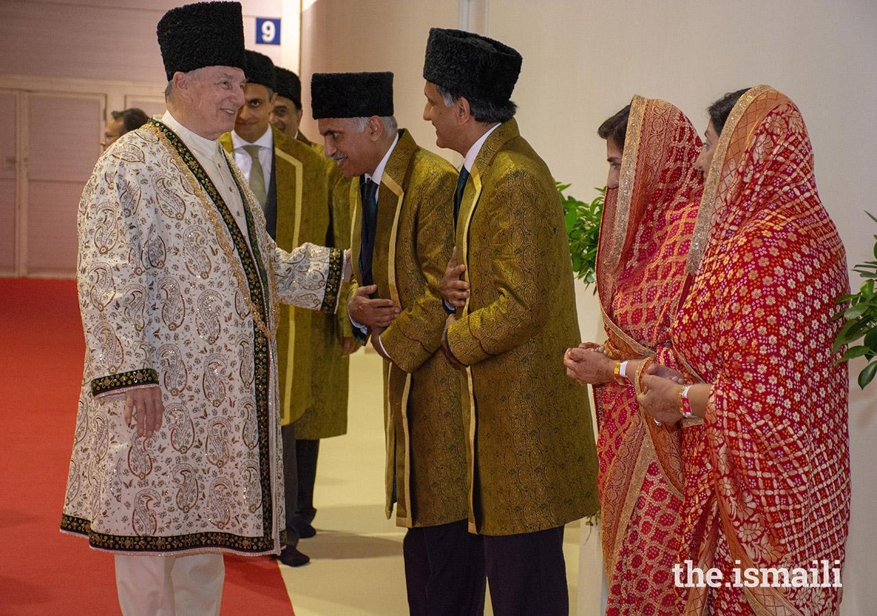 Mawlana Hazar Imam is welcomed by Mukhi Saheb, Mukhiani Saheba, Kamadia Saheb, and Kamadiani Saheba of Lisbon Darkhana.