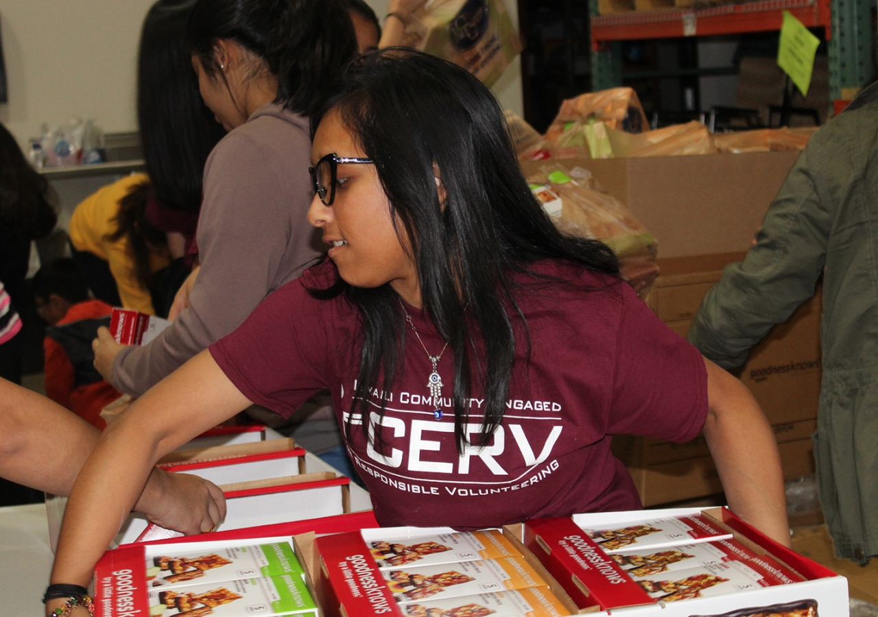 Niha Mitha helps sort food at the Midwest Food Bank in Atlanta, along with other members of the southeastern I-CERV team. Saba Verani