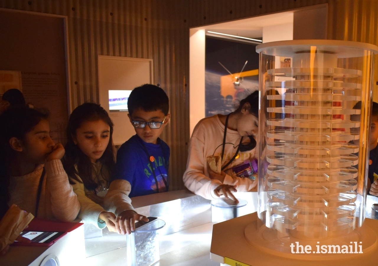 At the Science Museum in London, students use light reflectors to generate enough solar energy to power a light tower.