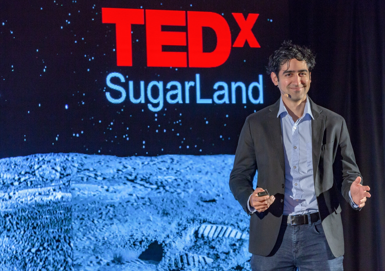 """Dr. Ben Jawdat, Founder and CEO at Revterra, presenting on the topic """"Clean Energy's Dirty Secret,"""" at TEDxSugarLand."""