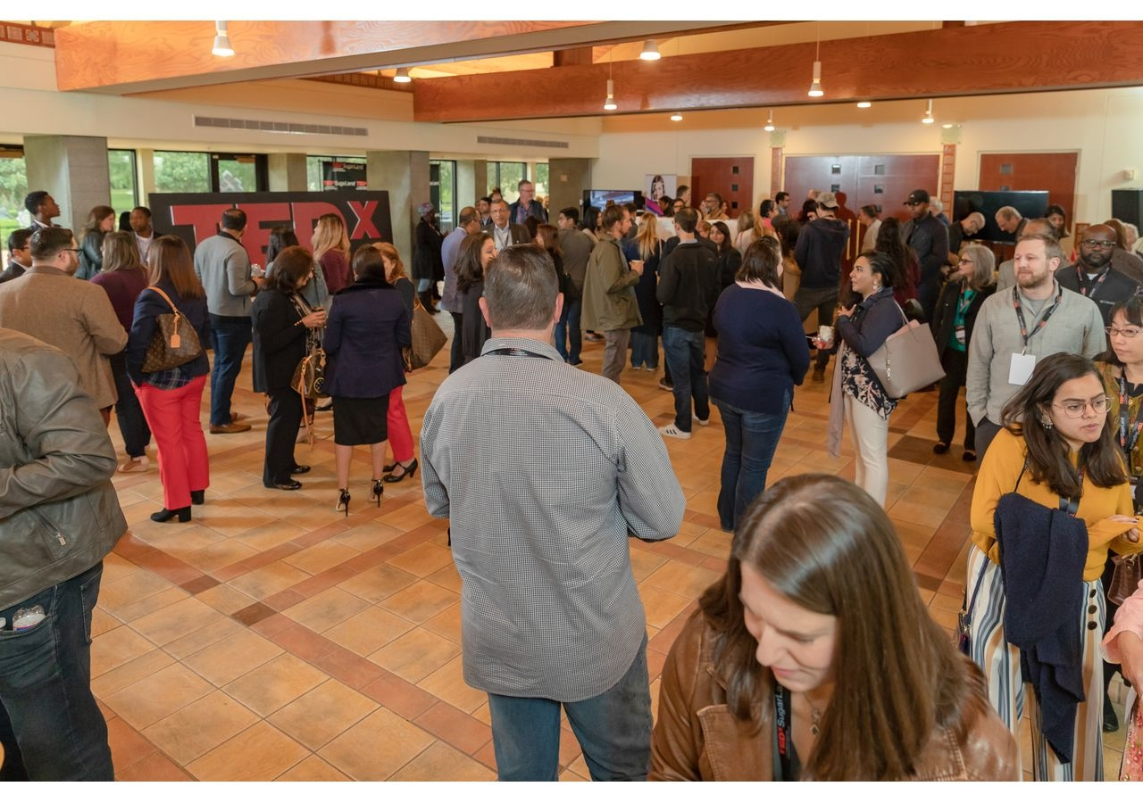 Attendees networking at the TEDxSugarLand being held at Ismaili Jamatkhana and Center.