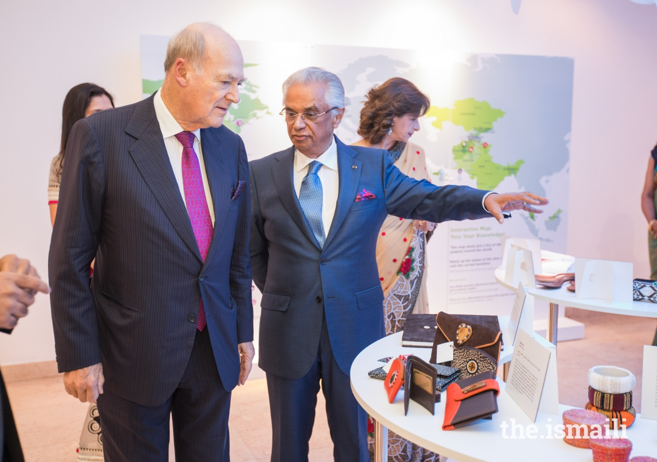 Prince Amyn and Nazim Ahmad observe the artefacts on display at the Ethics in Action exhibition.