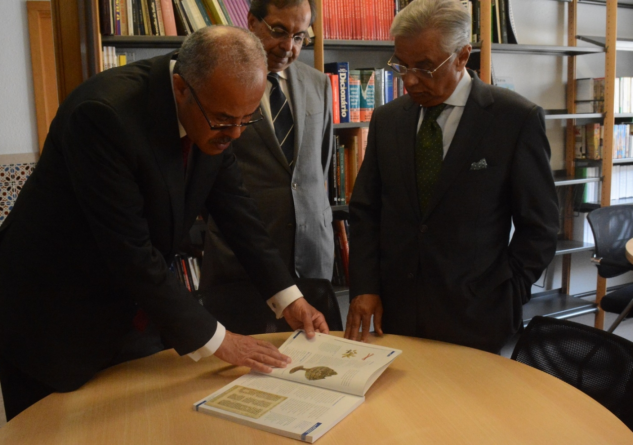 Egyptian Ambassador to Portugal Ali Mohyee Eldin Elashiry examines a book in the library of the Ismaili Centre, Lisbon. Nádia Silva
