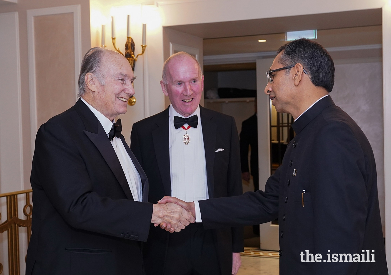 Mawlana Hazar Imam is received by HE Muhammad Ayub, Acting High Commissioner for Pakistan to the United Kingdom, and Sir William Blackburne, Chairman of the Pakistan Society, upon his arrival for The Pakistan Society's Annual Dinner.