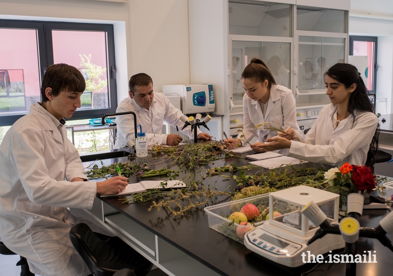 Anisa Abibulloeva (centre right) with classmates in the science laboratory at the University of Central Asia's Khorog campus.