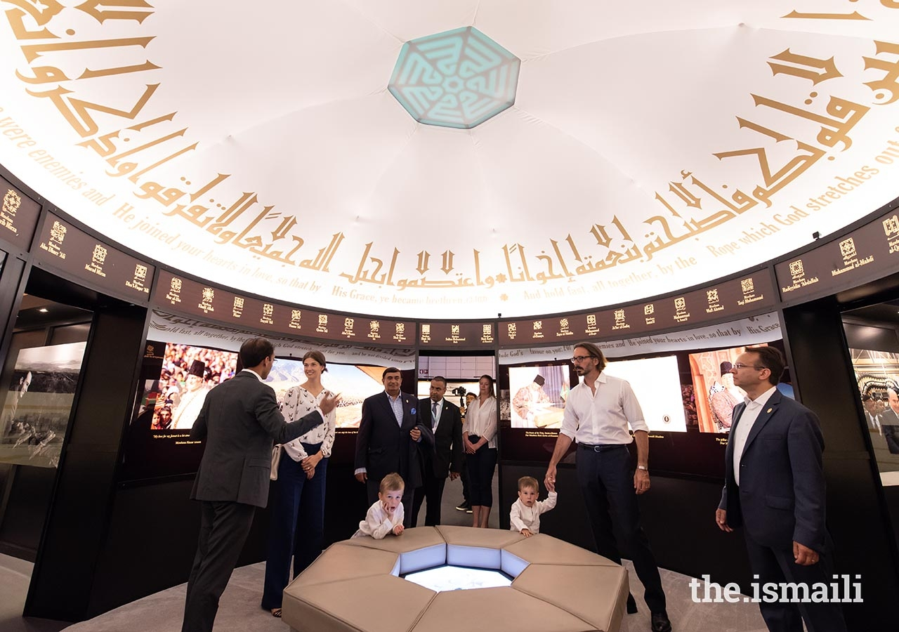 Prince Rahim, Princess Salwa, and young Princes Irfan and Sinan tour the Rays of Light exhibition in Lisbon.