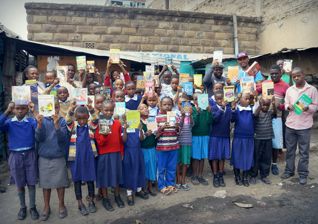 Children at Viara Junior Academy receive books as rewards for their commitment to learning. Courtesy of Bamba