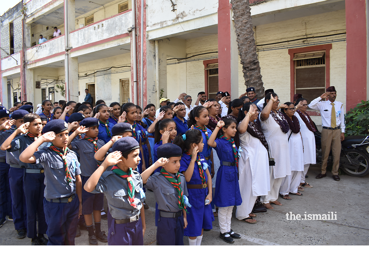 Volunteers, Scouts and Guides saluting the Chief Guest