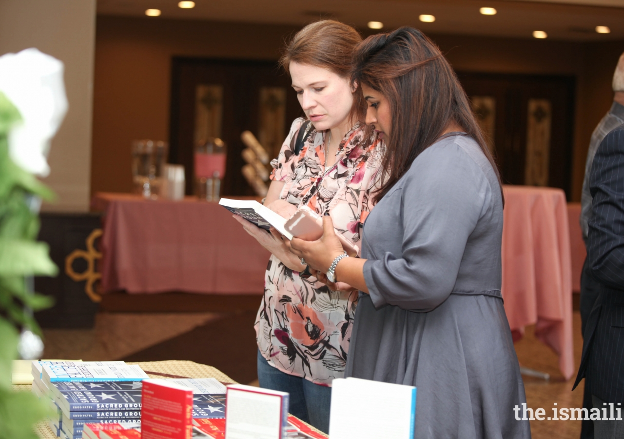 Guests are excited to pick up a copy of one of Dr. Eboo Patel's books.
